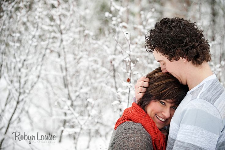 Engagement photography in the snow with red scarf.  Quesnel, Williams Lake and Cariboo BC Engagement Photography Photographer.  Available worldwide.  Engagements | Robyn Louise Photography Engagements | Robyn Louise Photography www.robynlouise.com #engagement #bc #williams #lake #photography #quesnel #cariboo #wedding #photographer #robynlouise #winter #snow #red