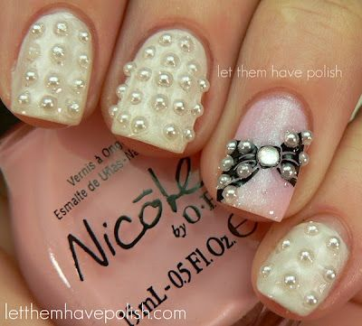 This is actually pretty cute only I'd want all my nails to be white with pearls. Just take out the ribbon. :)