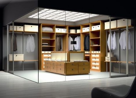 "Walk-in men's closet with glass walls by European cabinet maker ""Spazzi."""