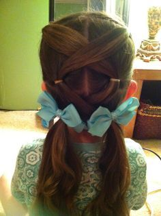 Cute little girls hair style - Our Daisy pony tail holders would look super cute on this hair style!