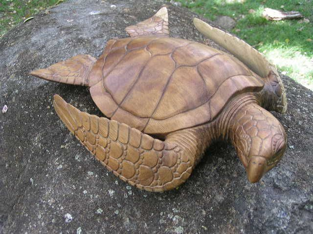 Here is a hand carved hawaiian turtle also known as honu