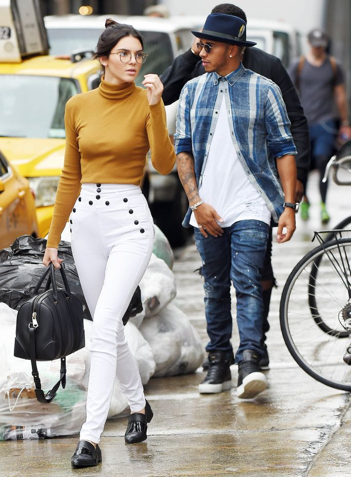 Kendall Jenner hits the streets of N.Y.C. in white jeans, a turtleneck, and glasses.