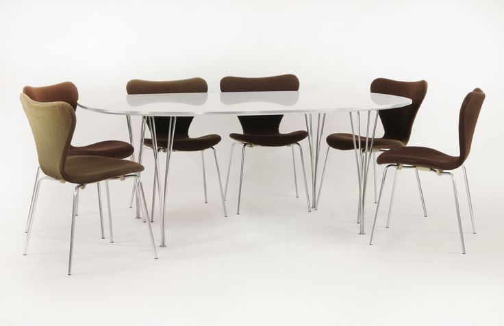 A Fritz Hansen dining room suite, designed in 1955, A super Elliptical table,  on chromed steel span legs,  and six 'Ant' chairs,  upholstered in brown fabric, marked Fritz Hansen £600-800