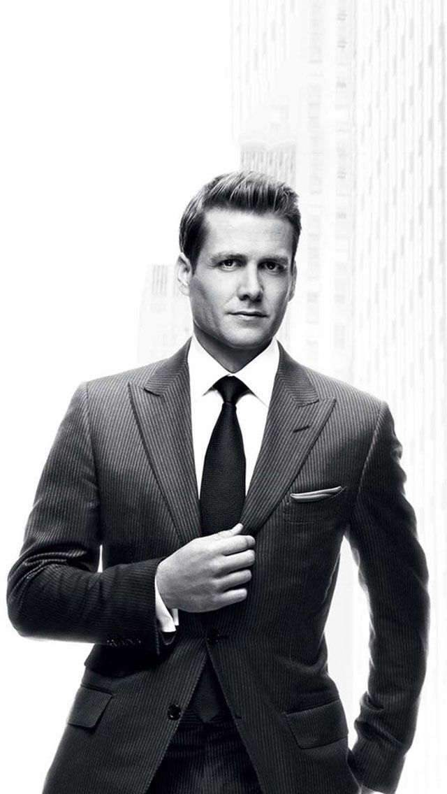 Harvey Spector, form the TV show Suits, has created a consistent look. He rotates between about 10 suits, all custom tailored by the exquisite Mr Tom Ford. Each suit has a traditional flapped pocket and a ticket pocket, a peaked lapel (a Tom Ford signature) and he wears a double windsor with a wider tie.