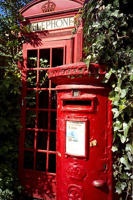 English phone box and Royal Mail post box hidden in the ivy