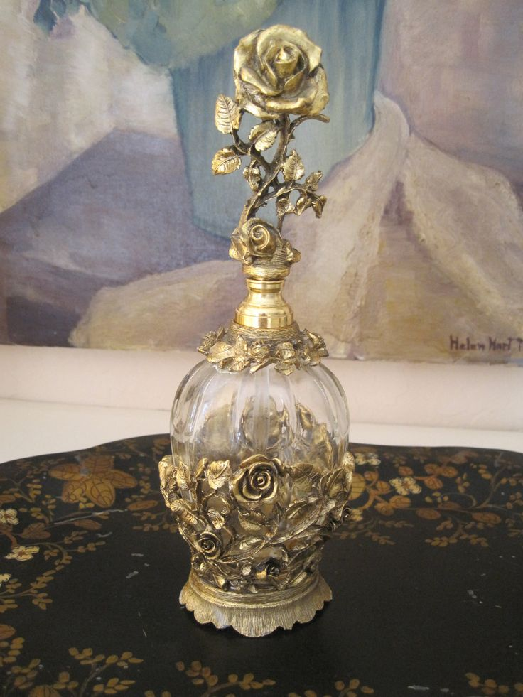 Perfume bottle with roses. Vintage Vanity. Dressing Table.
