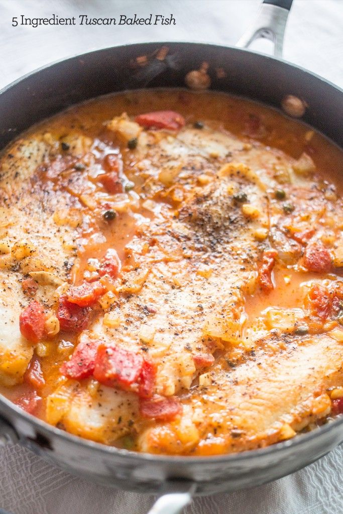 This One pot 5 ingredient tuscan baked fish is an easy, delicious one pan meal that makes fish flaky, non-fishy, and delicious for a family friendly meal!