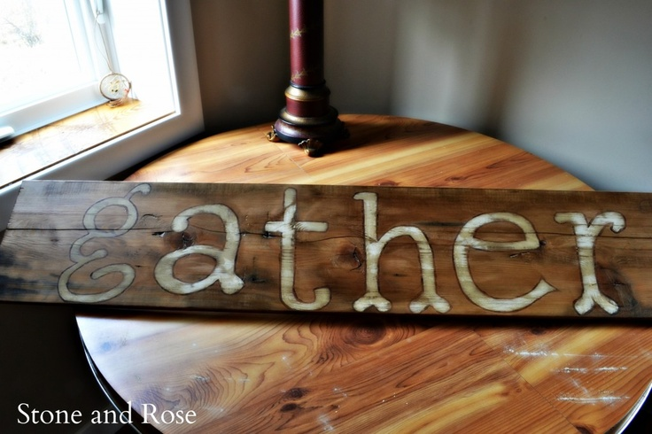 """I used a piece of barn board from our flooring, an overhead projector using the font """"Hulbert"""", Annie Sloan Chalk Paint in Old White (trim in Burnt Umber craft paint), and then AS Wax in Rustic after a good sanding."""