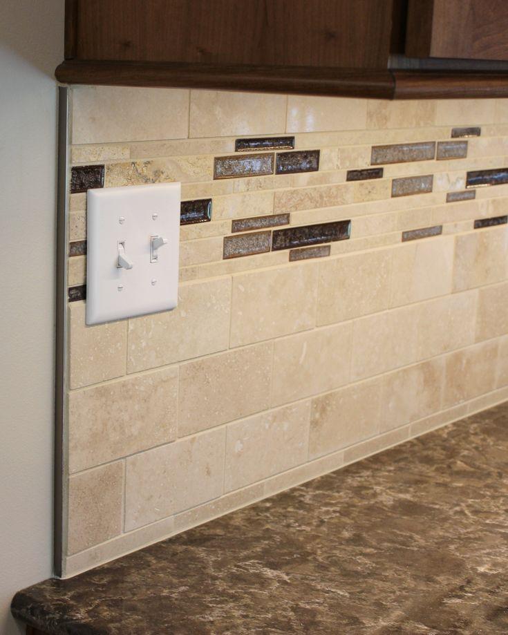 Schluter strip caps off a #Travertine #tile backsplash in an Erie, IL kitchen.   VillageHomeStores.com