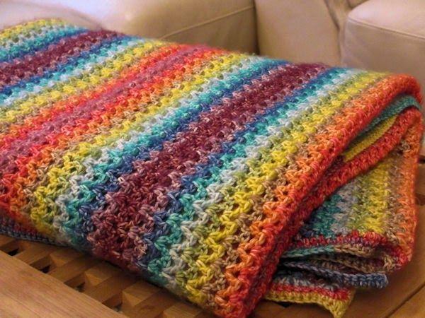 Blij dat ik brei: Warm, kleurig dekentje / Warm, colorful blanket, page is in Dutch with V-Stitch crochet diagram and links.