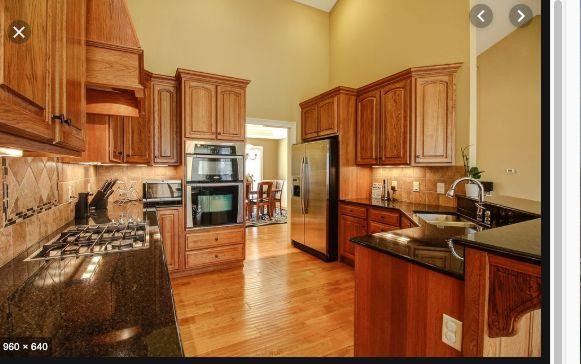 Oak floor kitchen, stone backsplash   Wood cabinets, Clean ...