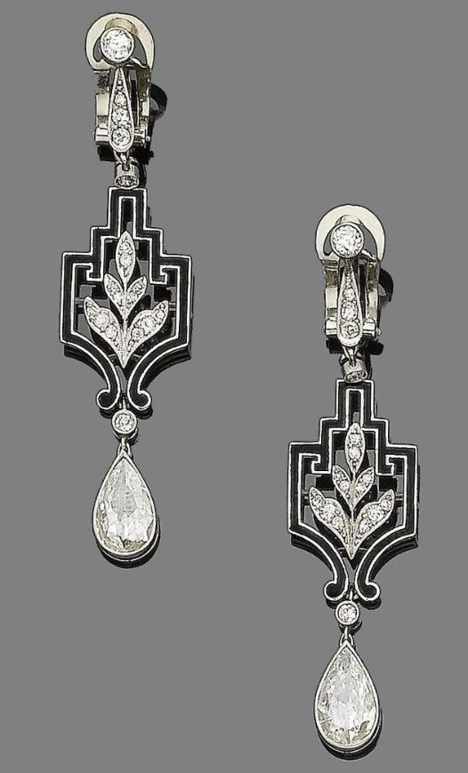 """""""A pair of art deco diamond and enamel pendent earrings, circa 1925. Each old brilliant and single-cut diamond surmount suspends a single-cut diamond foliate motif within a black enamel openwork geometric plaque, and terminates in a pear-shaped diamond drop, pear-shaped diamonds, approx. 3.30cts total, length 5.6cm."""" by corrine"""