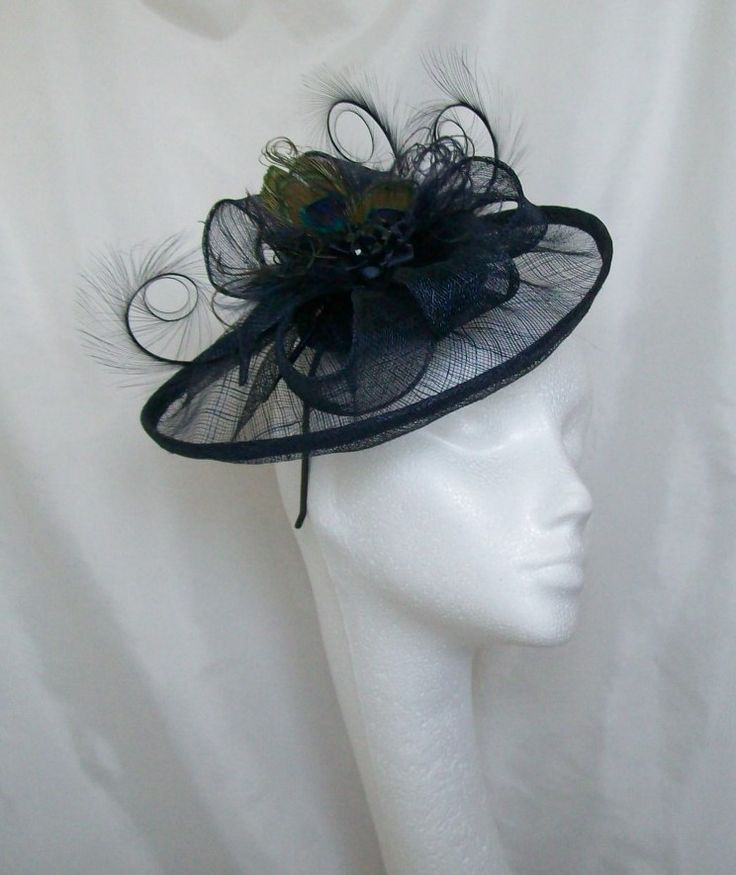 Navy Blue Peacock Lavinia. Order Now from www.indigodaisyweddings.co.uk Specialising in stunning bespoke cocktail fascinators and formal hats in a wide range of colours, perfect for Royal Ascot and The Kentucky Derby. Plus all your wedding floral accessories including shoe clips, vintage flapper bands, feather and flower fascinators, feather fans, fairy wands, wrist corsages, wedding bouquets & buttonholes. Worldwide Delivery.
