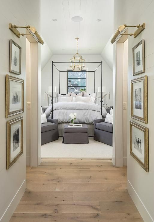 cool bedroom hallway with gold leaf picture frames and brass picture lights tr - Transitional Decor