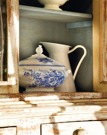 French country farmhouse: transfer ware tureen against the muted color of the painted hutch: