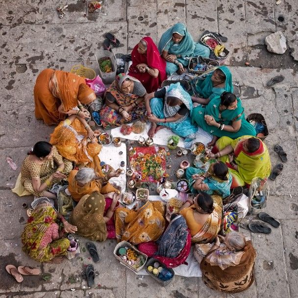 Group of women gather at Dasawamedh Ghat,  in the holy Hindu city of Varanasi to talk, sing, pray and make offerings