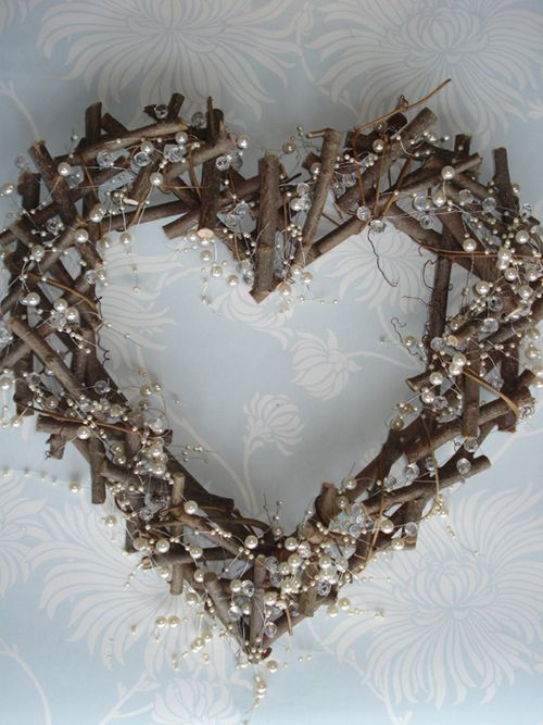 Driftwood & white flowers instead of pearls...above sweetheart table
