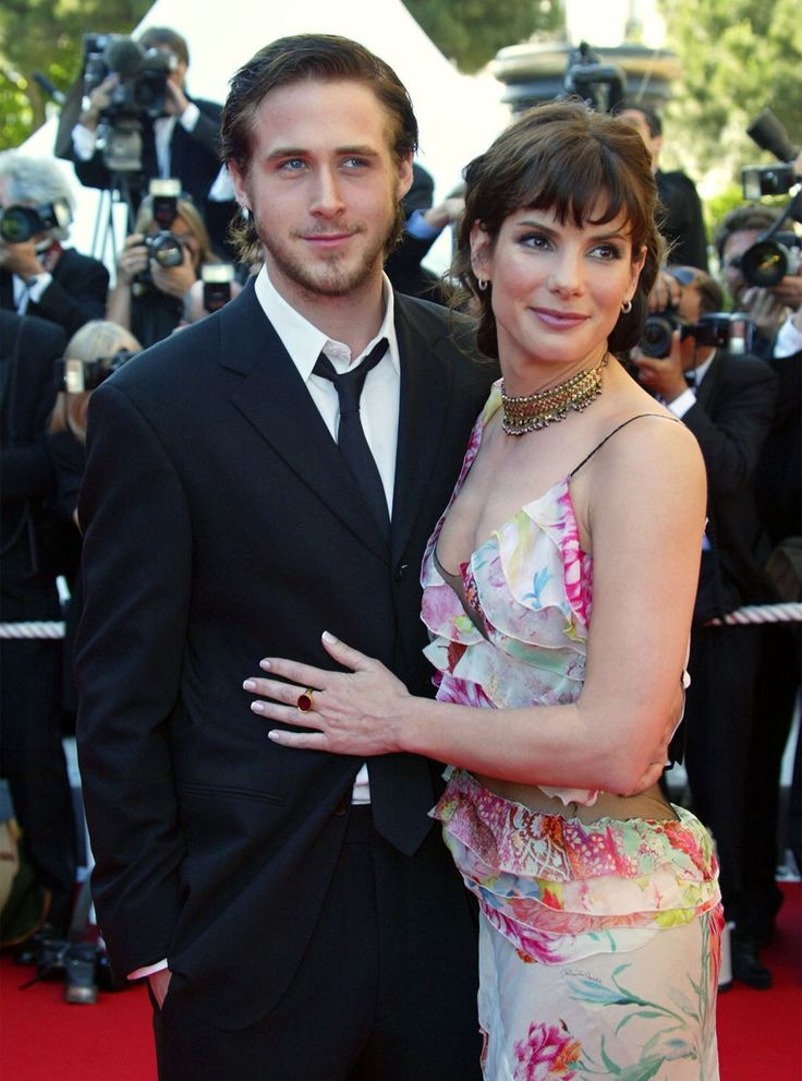 "Before he famously dated his The Notebook co-star Rachel McAdams, Ryan Gosling was romancing Sandra Bullock. The two met on the set of their 2002 film Murder By Numbers, and while their romance didn't last, Ryan later called Sandra and Rachel ""two of the greatest girlfriends of all time"". Aww!"