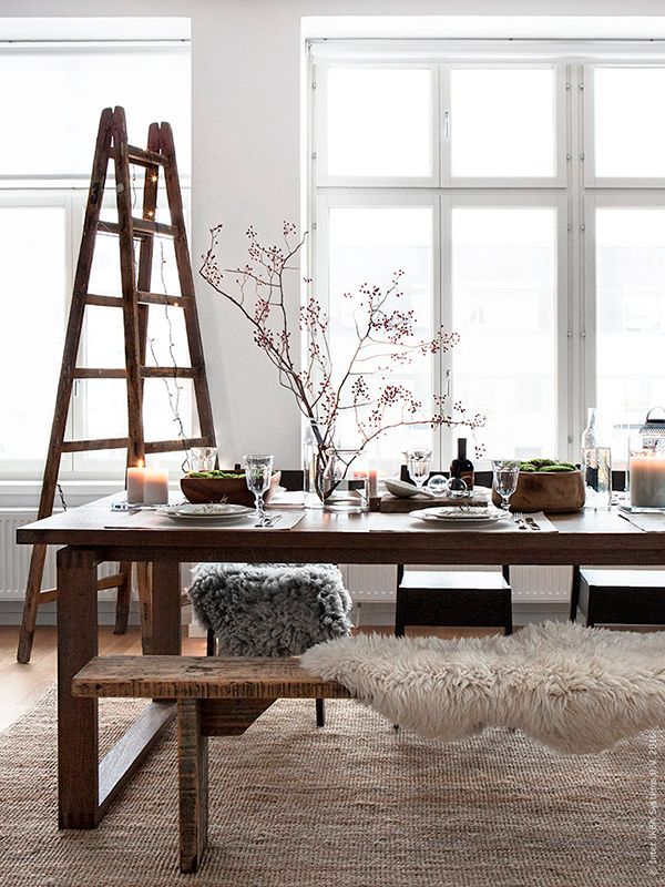 Scandinavian influences with simple wooden benches and furs. Like the ladder.