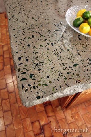 Do yourself concrete and wine bottle counter top. This will make such a unique kitchen