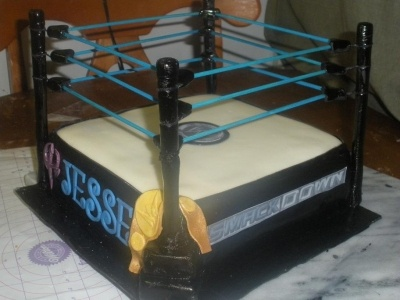 WWE Smackdown Wrestling Ring Cake By multilayered on CakeCentral.com
