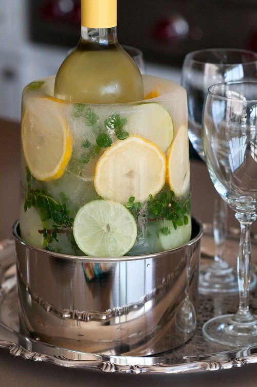 How to make a garnished ice ring for a wine or champagne bottle - from EntertainingCouple.com