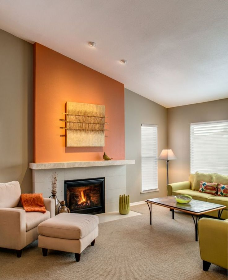 An Orange Accent Wall Stands Out In This Living Room