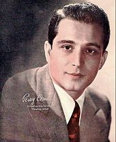 Perry Como.....Take a falling star and put it in your pocket, save for a rainy day...I remember this song from my childhood. He had just a nice soothing voice.