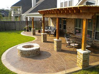 Patio Cover and cedar pergola with stamped concrete and fire pit Missouri City Sienna Plantation | by TexasCustomPatios