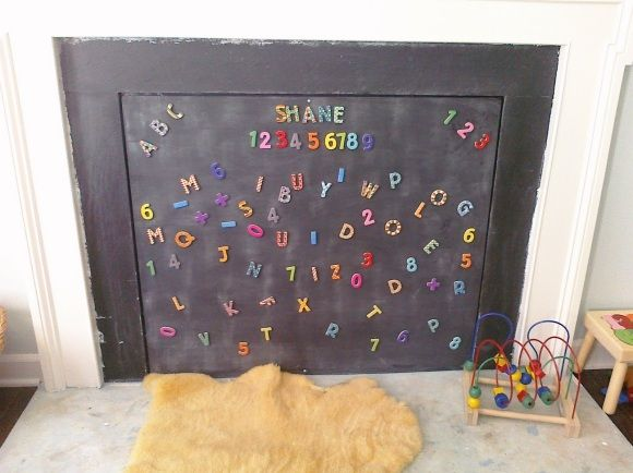 Fireplace cover- They bought some plywood, industrial strength magnets and screws, and magnetic and chalkboard paint. They alternated coats of magnetic and chalkboard paint on the plywood, then used the magnets and screws to securely attach it to the fireplace surround.