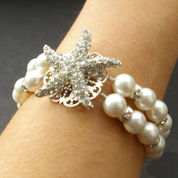 Bridal Starfish Bracelet, Pearl Bracelet, Crystal Starfish Bracelet, SEA MAIDEN. $75.00, via Etsy.