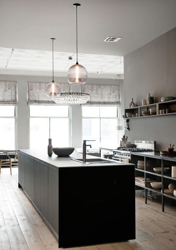 Kitchen from Valcucine and a couple of Niche Stamen Pendant Lamps over the island