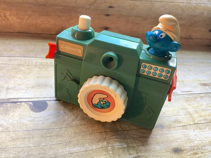 The 80s and Photography all in one! Vintage 1980s Mid Century Illco pre-School Smurf Musical Toy Camera with turning smurf head. by MelAbs on Etsy https://www.etsy.com/listing/525756716/vintage-1980s-mid-century-illco-pre