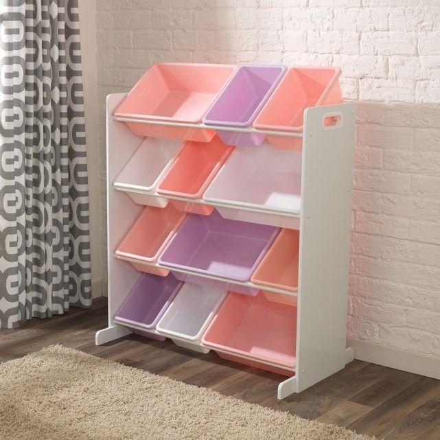 Meuble avec bacs de rangement aux couleurs pastel. Au revoir le désordre ! Ce meuble avec 12 bacs de rangement en plastique (rose, violet et blanc)est idéal pour organiser et ranger la chambre de vos enfants. Les bacs sont tous interchangeables. Ce meuble de rangement est une construction intelligente et solide, fabriquée en bois par Kidkraft. Dimensions : 83 cm L x 48 cm W x 92 cm H. Comprend des instructions détaillées pour l?assemblage étape par étape. Meuble blanc avec bacs de rangement…