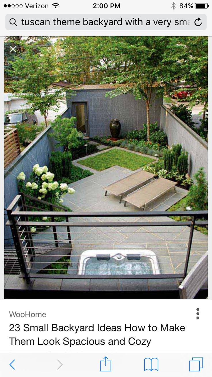 Urn fountain as focal point with planting around it. Small Backyard Home Design  Idea