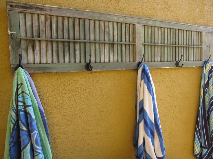 The Decorating Duchess: hooks on shutter for drying pool towels outside