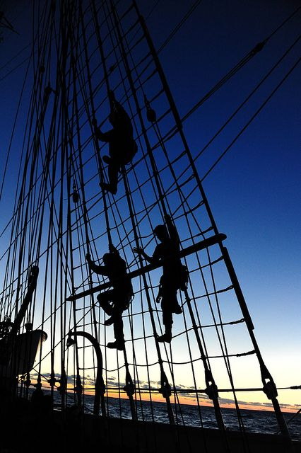 ATLANTIC OCEAN - U.S. Coast Guard Barque Eagle crewmembers and Coast Guard Academy officer candidates climb down the rigging aboard Coast Guard Barque Eagle Sept. 15, 2012. Officer candidates spend two weeks aboard the Eagle during their 17-week school to further develop their seamanship, teamwork and leadership skills. (U.S. Coast Guard photo by Petty Officer 1st Class Lauren Jorgensen) #coastie #coastguard