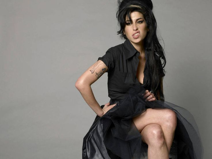 Amy Winehouse. The hair, the make up, reminiscent of Maria Callas.