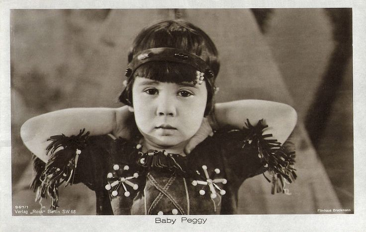 https://flic.kr/p/Pm2gj2 | Baby Peggy | German postcard by Ross Verlag, Berlin no. 967/1, 1925-1926.  Photo: Filmhaus Bruckmann.  Diana Serra Cary (1918), best known as Baby Peggy, was one of the three major American child stars of the Hollywood silent movie era along with Jackie Coogan and Baby Marie. The first film, Playmates in 1921, was a success, and Peggy was signed to a long-term contract with Century Studios. Between 1921 and 1923 she made over 150 short comedies for Century. In…