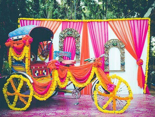 Photo booths with so much Color are total love ! Shot by @vivekkrishnanphotography | #decor #weddingdecor #kitsch #funky #neon #wedding #indianwedding #rickshaw #bride #bridal #weddingflorals #flowers #frames #color #fashion #unique #instapic #instagood #cute #marigold #elledecor #weddings #indiandecor #kitschdecor #love #funk #color