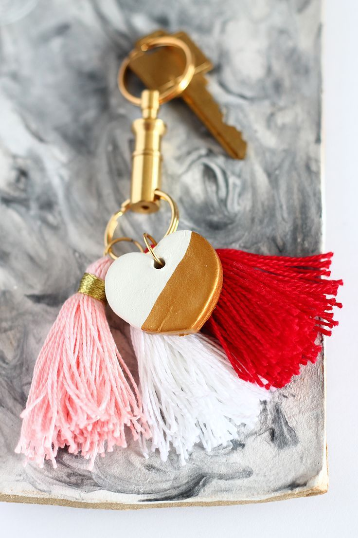 Make an air dry clay heart, dip it in gold paint and make some tassels to create this cute keychain   Squirrelly Minds