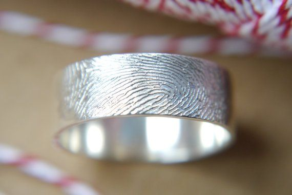 This wedding band is made using your actual fingerprint.  Cool idea.