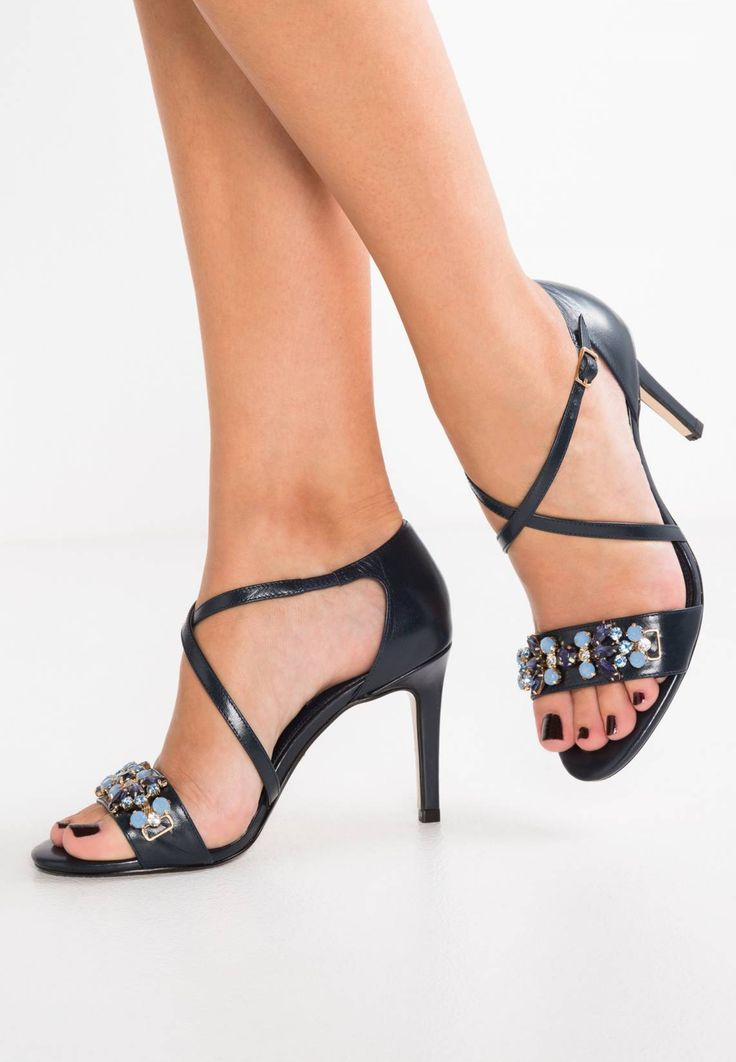 "Dune London. MARCELA - Sandals - navy . Sole:synthetics. heel height:3.5 "" (Size 4). Padding type:Cold padding. Shoe tip:open. Heel type:stiletto. Lining:imitation leather/ textile. detail:rhinestones,elasticated. shoe fastener:buckle/bo..."