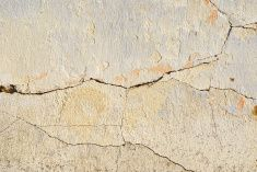 Cracked wall on the old house stock photo