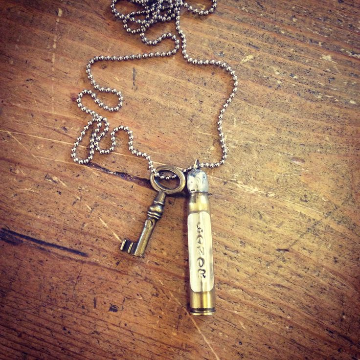 Shotgun shell necklace from my grandfathers 21 gun salute at his burial. Wonderfully crafted and embellished by the lovely Elizabeth of http://fussbucketsworld.blogspot.com