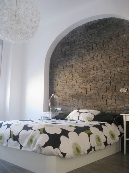 Love the brick wall headboard. They used the ikea light too for the ceiling.