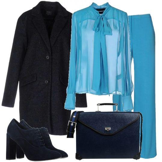 Look che ruba qualche idea al guardaroba maschile, dandogli, però una impronta molto femminile: pantaloni turchesi a vita alta, abbinati ad una camicia in seta con fiocco, cappotto classico blu scuro, stringate scamosciate rigorosamente con il tacco e borsa da lavoro in pelle blu. Per un tocco sexy si può inserire, sotto la camicia trasparente, della lingerie con il pizzo, in colore contrastante. Nelle giornate più fredde, sopra la camicia può essere inserito un cardigan blu, ampio e aperto.