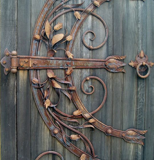 Wow! After Curt learns Black Smithing at the John C. Campbell Folk School I'm having him make hardware for our door like this!!!