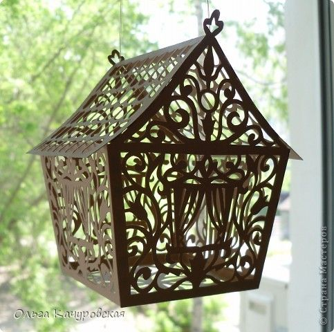 Papercut house tutorial with templates - these might make pretty centerpieces with battery powered tea lights inside or a couple of flowers outside