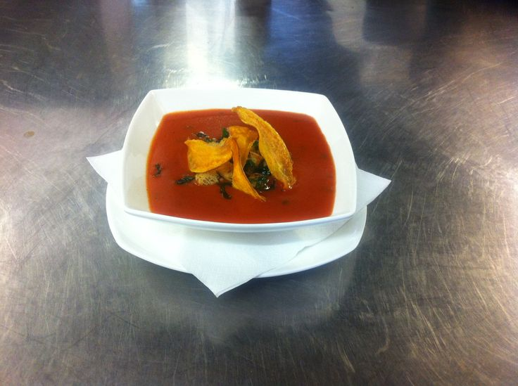 Tomato and roasted red pepper soup with butternut squash croutons.